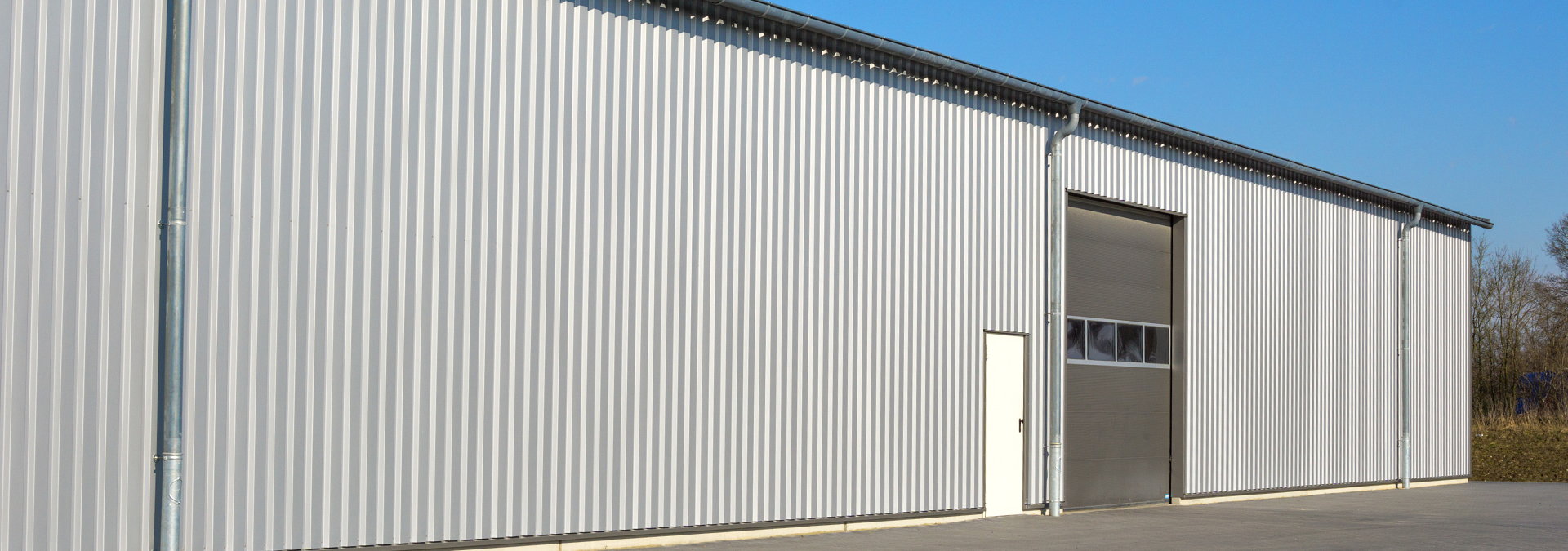 Custom metal siding on building by LBH Timber Mart