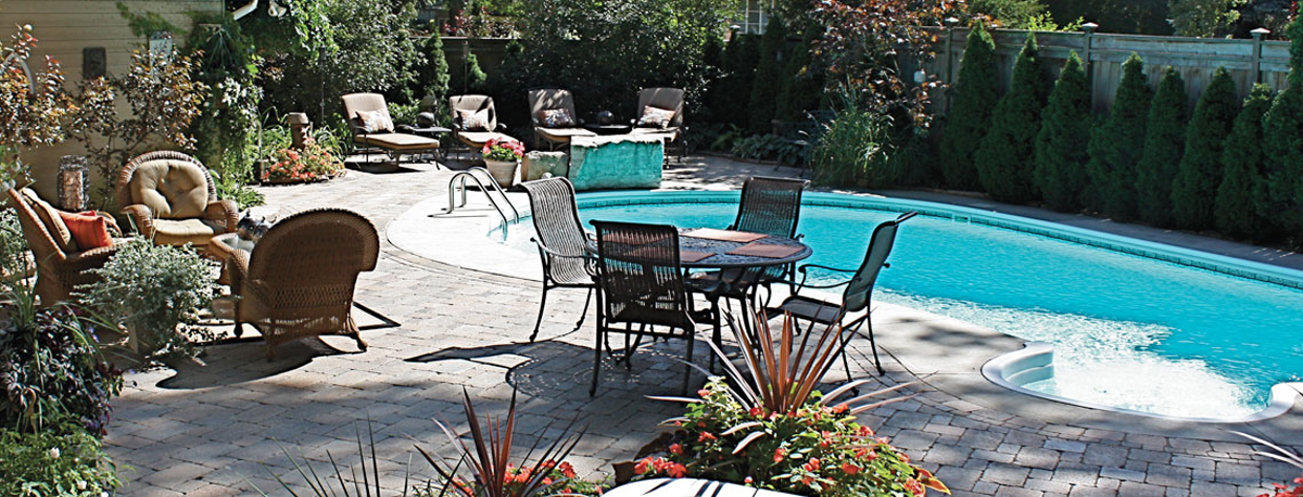 Patio set in front of pool in summer