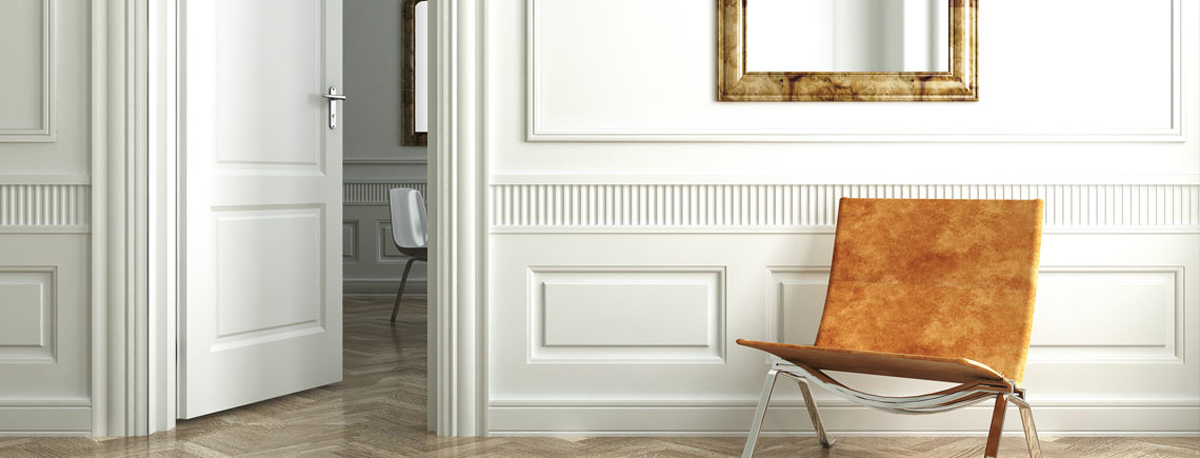 Decorative moulding and doors inside well lit room