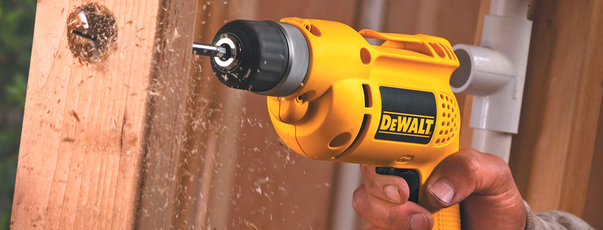 Power drill being used to build fence
