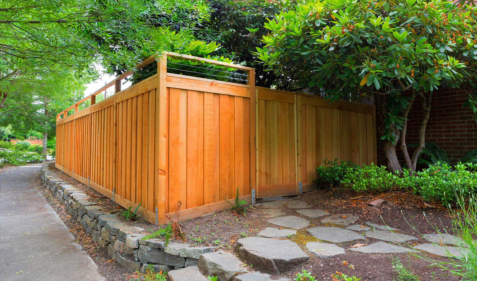 Fencing made from Red Cedar wood surrounded by gardens
